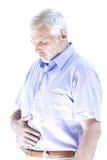 Senior man portrait suffer stomachache. Caucasian senior man portrait suffer stomachache isolated studio on white background Royalty Free Stock Photo