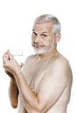 Senior man portrait take medecine pill annoyed Stock Photo
