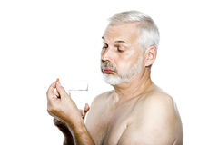 Senior man portrait taking medecine capsule Royalty Free Stock Photos