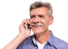 Senior man. Portrait of senior man is talking by phone royalty free stock photo