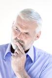 Senior man portrait thinking Stock Image