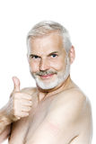 Senior man portrait thumb up nicotine patch Stock Photo