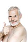 Senior man portrait thumb up nicotine patch Stock Photo