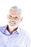 Senior man portrait toothy smile. Caucasian senior man portrait toothy smile isolated studio on white background Royalty Free Stock Image