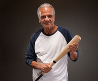 Senior man posing with baseball bat Stock Images