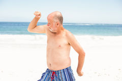 Senior man posing with his muscles Royalty Free Stock Photos
