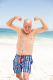 Senior man posing with his muscles Royalty Free Stock Images
