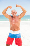 Senior man posing with his muscles Stock Images
