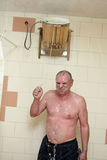 Senior man pouring bucket of water on himself. After sauna Royalty Free Stock Photography
