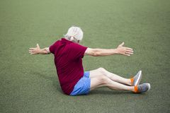 Senior man exercising in an open stadium royalty free stock image