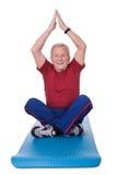 Senior Man Practicing Yoga Royalty Free Stock Image