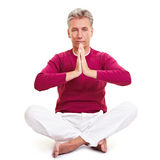 Senior man praying. Relaxed senior man folding his hands for a prayer royalty free stock images
