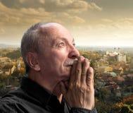 Senior man praying Stock Images