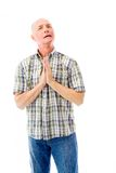 Senior man praying Stock Image