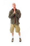 Senior man praying Stock Photo