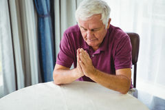 Senior man praying Royalty Free Stock Photography
