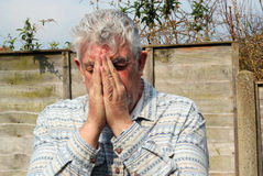 Senior man praying. Royalty Free Stock Images