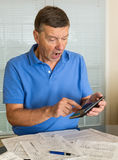 Senior man preparing USA tax form 1040 for 2012 Royalty Free Stock Photo