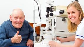 Senior Man With Presbyopia. Hppy senior men with presbyopia at an optical examination Royalty Free Stock Images