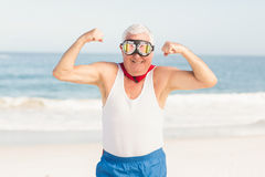 Senior man pretending to be a superhero. On a sunny day Royalty Free Stock Images