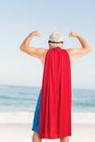 Senior man pretending to be a superhero. On a sunny day Stock Photography