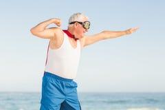 Senior man pretending to be a superhero. On a sunny day Stock Photos