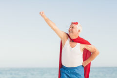 Senior man pretending to be a superhero. On a sunny day Stock Image