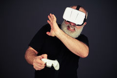 Senior man protect his face playing in virtual reality Royalty Free Stock Images