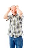 Senior man pulling his hair and screaming in frustration Royalty Free Stock Photos