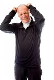 Senior man pulling his hair and screaming in frustration Royalty Free Stock Photography
