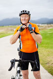 Senior man putting on cycling helmet Royalty Free Stock Images