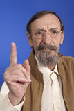 Senior man raising finger Stock Photo