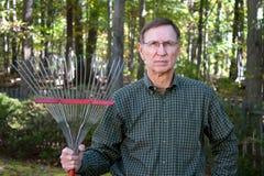 Senior Man With Rake Stock Images