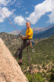 Senior man rappelling in Colorado Stock Photo