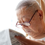 A senior man is reading Royalty Free Stock Photo