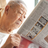 A senior man is reading. Newspaper Royalty Free Stock Photo