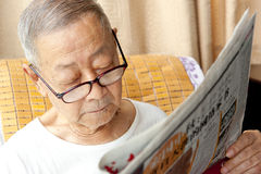A senior man is reading. Newspaper Stock Photo