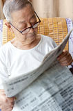A senior man is reading. Newspaper Royalty Free Stock Images