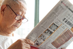 A senior man is reading. Newspaper Royalty Free Stock Photos