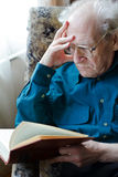 Senior Man Reading Stock Image