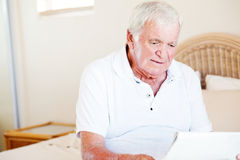 Senior man reading Stock Photography