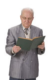 Senior man reading. Image of a senior man reading a book against a white background Stock Image