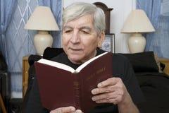 Senior man reading Bible Stock Photo