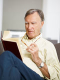 Senior man reading book Stock Photos