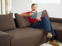Senior man reading book Stock Photo