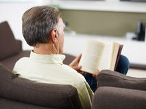Senior man reading book Stock Photography