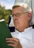 Senior Man reading book stock photo