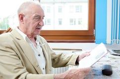 Senior man is reading Stock Photo