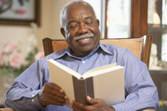 Senior man reading book royalty free stock photography