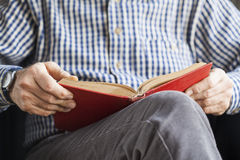 Senior man reading book. Senior man hands reading book Stock Photography